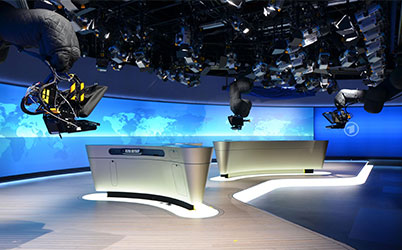 Robotic camera in news studio